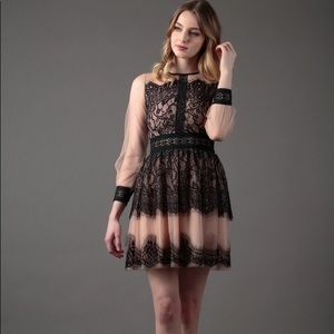 Tulle and embroidered layered dress
